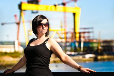 This was an experiment out in the full and hard direct sunlight. Lora was facing almost directly into the sun which is why I asked her to wear her sunglasses as squinting isn't attractive in a portrait. With such an iconic Belfast backdrop who could resist shooting it?